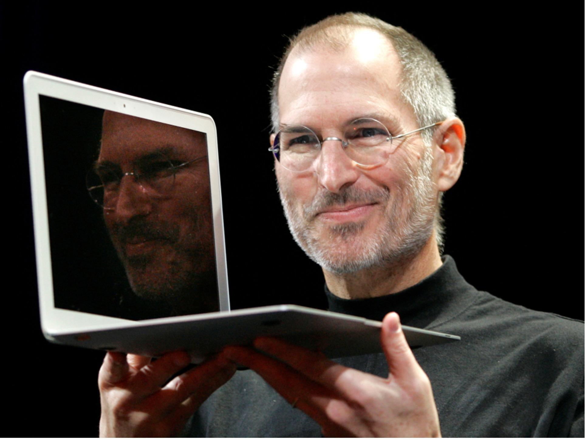 Apple Steve Jobs Holding a MacBook