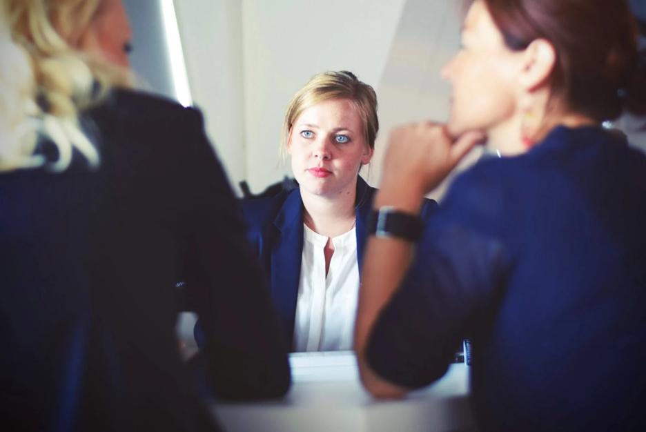 three women at a meeting